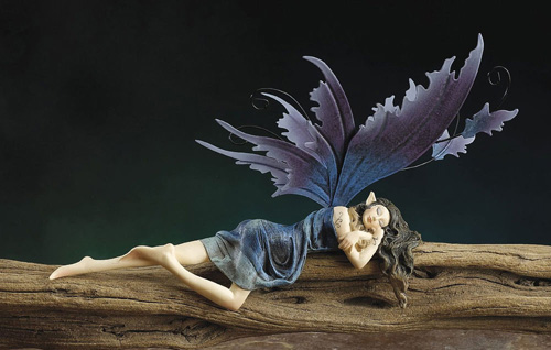 DREAM FAIRY LYING ON SHELF