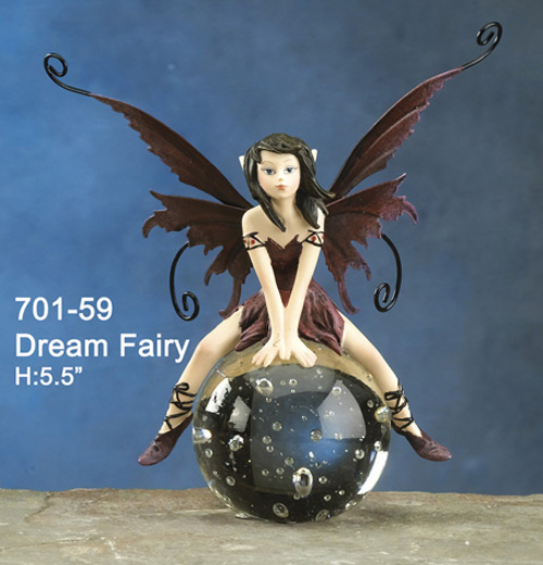 DREAM FAIRY SITTING ON GLASS BALL